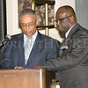 Master of Ceremonies Anthony Johnson discusses the program with Glendon Fraser during the 19th Annual Tuition Assistance Awards Celebration of the Major General Irene Trowell-Harris Chapter of the Tuskegee Airmen on Saturday, February 4, 2017 at Anthony's Pier 9 in New Windsor, NY. Hudson Valley Press/CHUCK STEWART, JR.