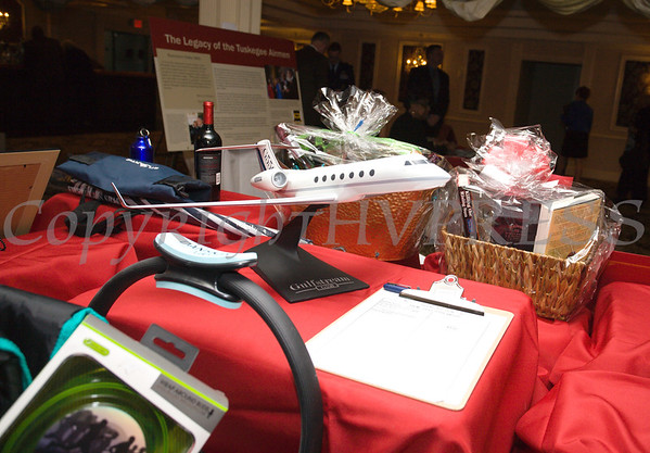 There were plenty of items to bid on during the silent auction of the 19th Annual Tuition Assistance Awards Celebration of the Major General Irene Trowell-Harris Chapter of the Tuskegee Airmen held on Saturday, February 4, 2017 at Anthony's Pier 9 in New Windsor, NY. Hudson Valley Press/CHUCK STEWART, JR.