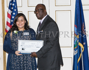 Award recipient Jennifer Sandoval receives an oversized check from Glendon Fraser during the 19th Annual Tuition Assistance Awards Celebration of the Major General Irene Trowell-Harris Chapter of the Tuskegee Airmen on Saturday, February 4, 2017 at Anthony's Pier 9 in New Windsor, NY. Hudson Valley Press/CHUCK STEWART, JR.