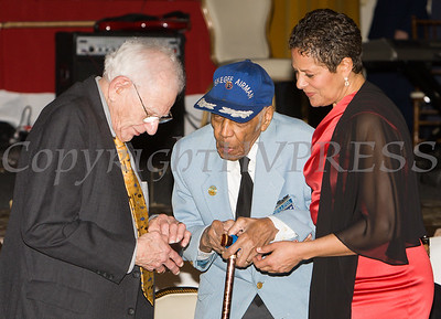 "B-17 navigator Harvey Horn and Tuskegee Airmen ""Coach"" Roscoe Draper talk with Anne Palmer during the 19th Annual Tuition Assistance Awards Celebration of the Major General Irene Trowell-Harris Chapter of the Tuskegee Airmen on Saturday, February 4, 2017 at Anthony's Pier 9 in New Windsor, NY. Hudson Valley Press/CHUCK STEWART, JR."