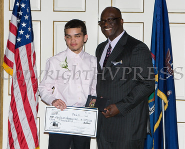 Award recipient Adelson Aguasvivas receives an oversized check from Glendon Fraser during the 19th Annual Tuition Assistance Awards Celebration of the Major General Irene Trowell-Harris Chapter of the Tuskegee Airmen on Saturday, February 4, 2017 at Anthony's Pier 9 in New Windsor, NY. Hudson Valley Press/CHUCK STEWART, JR.