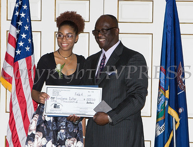 Award recipient Suetanya Euter receives an oversized check from Glendon Fraser during the 19th Annual Tuition Assistance Awards Celebration of the Major General Irene Trowell-Harris Chapter of the Tuskegee Airmen on Saturday, February 4, 2017 at Anthony's Pier 9 in New Windsor, NY. Hudson Valley Press/CHUCK STEWART, JR.