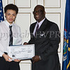 Award recipient Tygeer Carruthers receives an oversized check from Glendon Fraser during the 19th Annual Tuition Assistance Awards Celebration of the Major General Irene Trowell-Harris Chapter of the Tuskegee Airmen on Saturday, February 4, 2017 at Anthony's Pier 9 in New Windsor, NY. Hudson Valley Press/CHUCK STEWART, JR.
