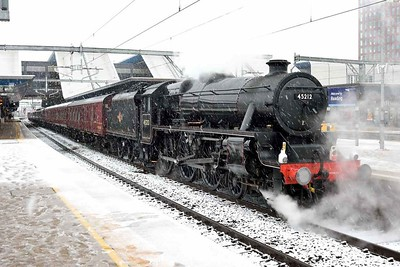 10 December 2017 :: A Black 5 in the snow  at Reading!  LMS Class 5MT 4-6-0 no 45212 leads 1Z34, The Cathedrals Express from Slough to Stratford-upon-Avon.  The train had just been terminated by Network Rail due to the line being closed between Didcot add Oxford due to the adverse weather conditions