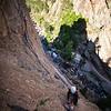 Ezra on the classic route <i>Bastille Crack 5.7</i> in Eldorado Canyon.