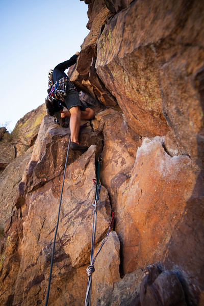 Ezra on the classic route <i>Bastille Crack 5.7</i> in Eldorado Canyon.