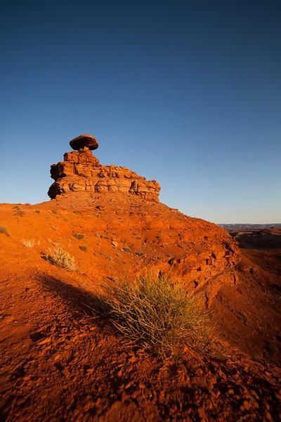 Morning sun falls down the walls at Mexican Hat, Utah.