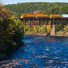 Three orange units make up for the still green color at Millers Falls. Southbound NECR 611 crossing the Millers Falls High Bridge on October 20, 2017.