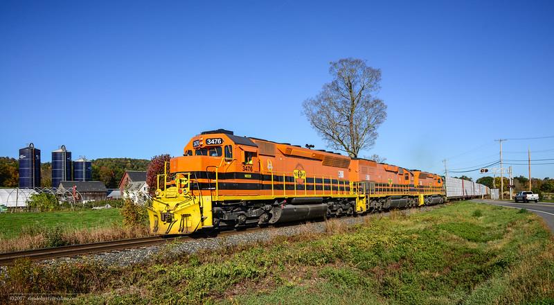 NECR train 611 crosses route 142 in Vernon, Vermont on October 20, 2017.