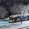 A route 72 Huron Ave Bus travels down Aberdeen Ave in first snow December.