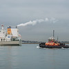 The tug Freedom and the tanker New England in Boston Harbor.