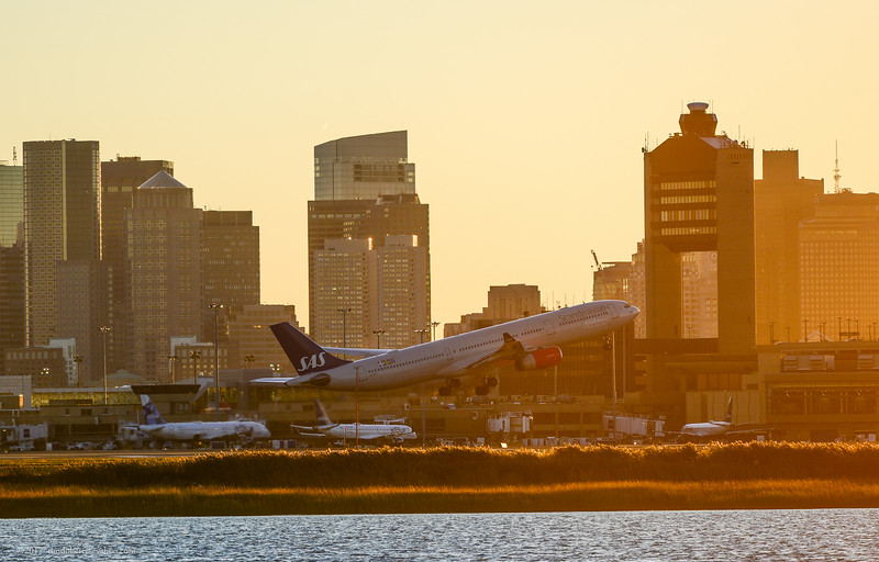 SAS's Boston to Copenhagen flight departs Logan Airport just before sunset on October 1, 2017.