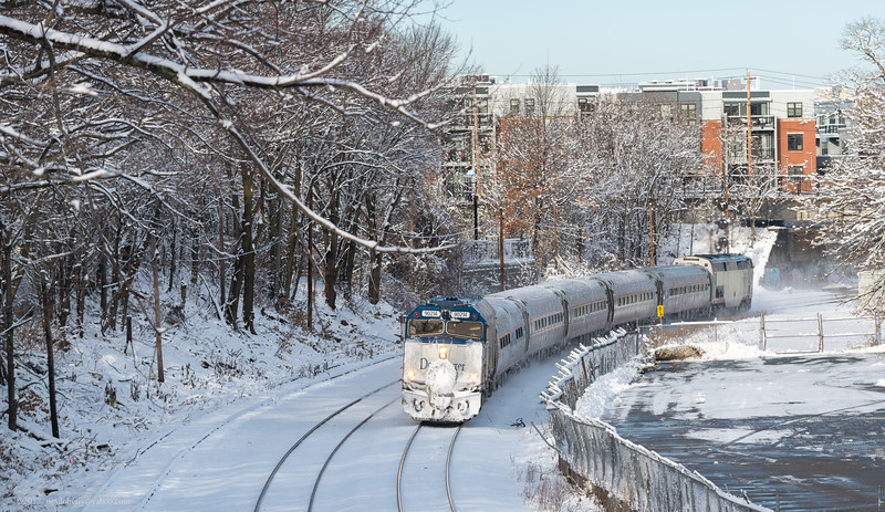 The first inbound Downeaster passes through Somerville Jct on the New Hampshire route.