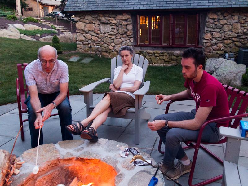 Richard, Chantal, and Benjamin at the firepit