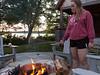 Isabel tending the firepit