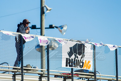 A race fan next to a Rhino Ag banner