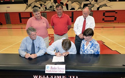 Hartsville High School's Haydon Norwood signs a letter of intent on April 13, 2017 to play golf for Presbyterian College.