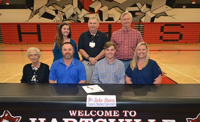 Hartsville High School's Zeke Steen takes a photo with family after signing a letter of intent on April 13, 2017 to play golf for Francis Marion University.