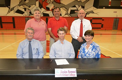 Hartsville High School's Haydon Norwood takes a photo with family and school administrators after signing a letter of intent on April 13, 2017 to play golf for Presbyterian College.