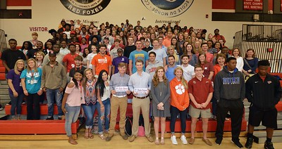 Hartsville High School's Haydon Norwood and Zeke Steen gather with classmates after signing letters of intent on April 13, 2017 to play collegiate golf.