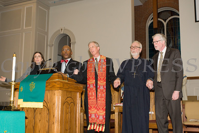 """The Rev. Dr. Edward L. Hunt (second from left), joins hands with other clergy as they sing """"We Shall Overcome"""" as Bethel Missionary Baptist Church hosted the 29th Annual Dr. Martin Luther King Jr. Community Commemorative Service Sunday, January 15, 2017 in Wappingers Falls, NY. Hudson Valley Press/CHUCK STEWART, JR."""