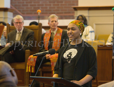 """Danielle Joyner recites the poem """"God Why Did You Make Me Black"""" during the Bethel Missionary Baptist Church hosted 29th Annual Dr. Martin Luther King Jr. Community Commemorative Service Sunday, January 15, 2017 in Wappingers Falls, NY. Hudson Valley Press/CHUCK STEWART, JR."""