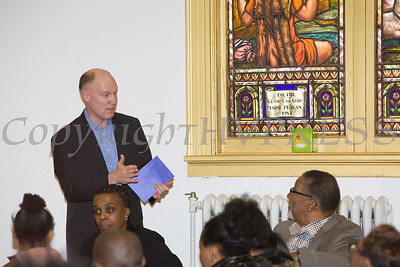 Patrick Normoyle, one of Mill Street's partners, answers a question regarding taxes during the Black History Committee of the Hudson Valley 49th Annual Martin Luther King Jr Celebration on Monday, January 16, 2017 at New Hope Baptist Church in Newburgh, NY. Hudson Valley Press/CHUCK STEWART, JR.