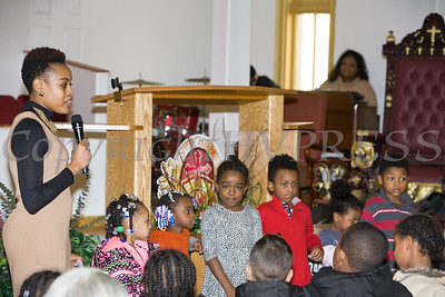 Mrs. Shawna Newkirk-Reynolds with children from her workshop discuss what they learned during the Black History Committee of the Hudson Valley 49th Annual Martin Luther King Jr Celebration on Monday, January 16, 2017 at New Hope Baptist Church in Newburgh, NY. Hudson Valley Press/CHUCK STEWART, JR.