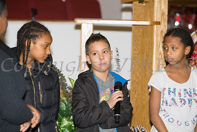 A child talks about what he learned during the Black History Committee of the Hudson Valley 49th Annual Martin Luther King Jr Celebration on Monday, January 16, 2017 at New Hope Baptist Church in Newburgh, NY. Hudson Valley Press/CHUCK STEWART, JR.