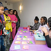 Young girls receive pens and paper from Ya'Nasia Black, Zoe Graves and Annette Vasquez to write soldiers thank you notes during the Newburgh Girl Power Program Third Annual Day of Service for Girls in honor of Martin Luther King Jr. on Monday, January 16 at Safe Harbors of the Hudson in Newburgh, NY. Hudson Valley Press/CHUCK STEWART, JR.