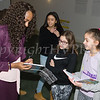 Guest speaker Asheena Baez signs journal books for participants of the Newburgh Girl Power Program Third Annual Day of Service for Girls in honor of Martin Luther King Jr. on Monday, January 16 at Safe Harbors of the Hudson in Newburgh, NY. Hudson Valley Press/CHUCK STEWART, JR.