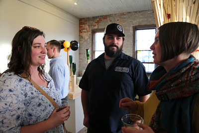 Guests talk to LauraMortimore at the opening.