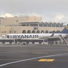Ryanair Boeing 737-800 EI-DYA and two Cobus 3000 buses at Malta Airport.