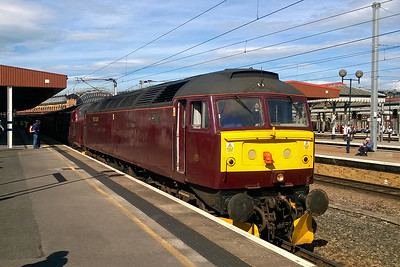 On a scorching hot Summer's afternoon, 47245 waits to depart from York with 1Z43 1657 return charter to Kings Cross via Chesterfield, Toton and Stamford, the outward leg of which had been steam hauled. In tow is 37706, which unfortunately had to be called into action at Peterborough North Junction after the 'Brush' lost most of its coolant (01/07/2017)