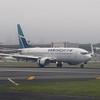 WestJet Boeing 737-800 C-GWSR landing at New York LaGuardia from Toronto.