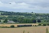 29 June 2017 :: With an RAF Hercules circling above the Wylie Valley, a FGW Class 150 passes Bapton on 2M98, the 1227 from Southampton to Great Malvern