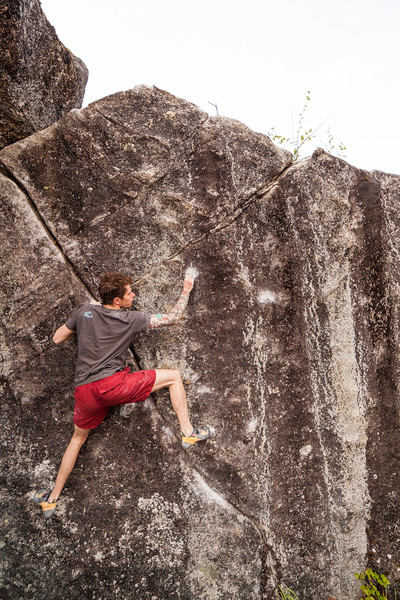 Kevin picks through the sequence on a V5 problem.
