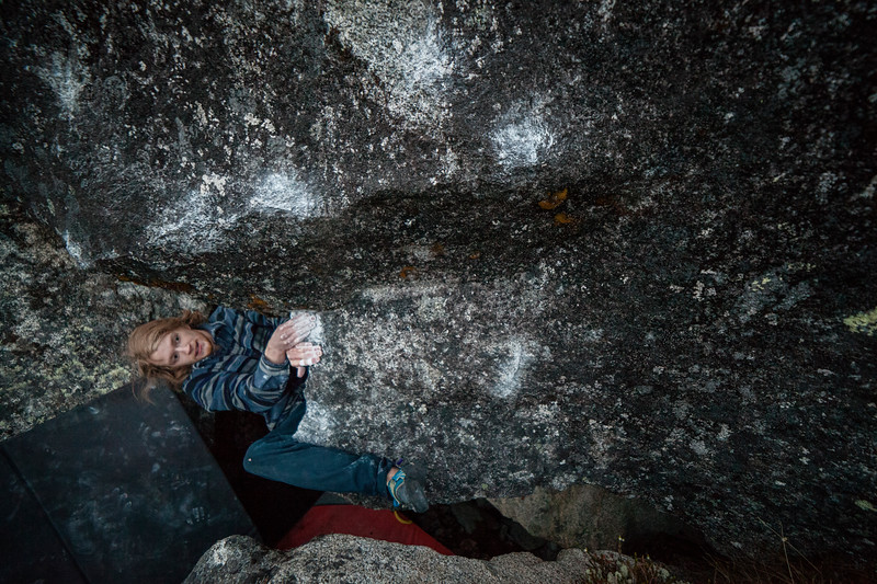 Riley eyes the holds ahead on this V5. Near midnight on a long Alaskan summer day.