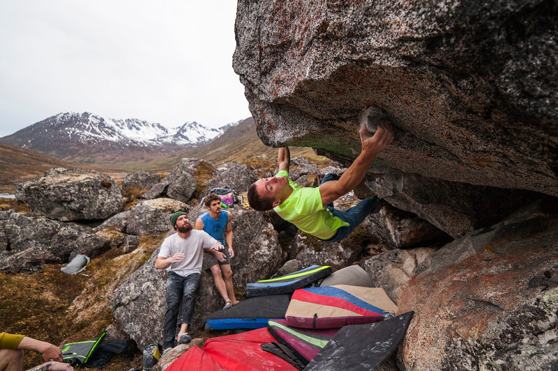 Brian moves into the crux on a V10.