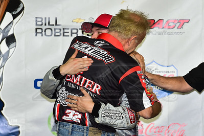 Bob Pierce hugs son Bobby Pierce