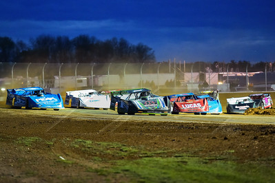 Josh Richards (1) and Don O'Neal (5) lead a heat race down the backstretch