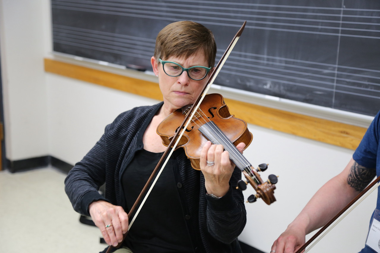 """A participant in the """"Making of Zarzuela"""" class taught by Brandi Berry and Paul Rowe, at the Madison Early Music Festival in the Humanities Building at the University of Wisconsin-Madison Mead Witter School of Music."""