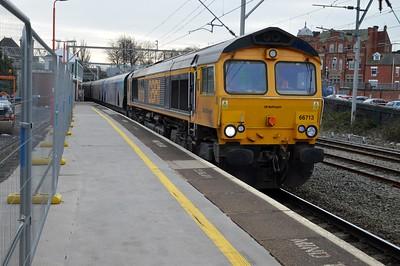 66713 1433/6E10 Liverpool-Drax passes Stockport.