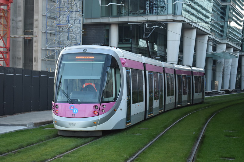 """Midland Metro CAF Urbos 3 tram no. 29 at the Birmingham Snow Hill """"St. Chads"""" stop on a Grand Central service."""