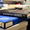 MET 030617 MATH BOOK CLOSE