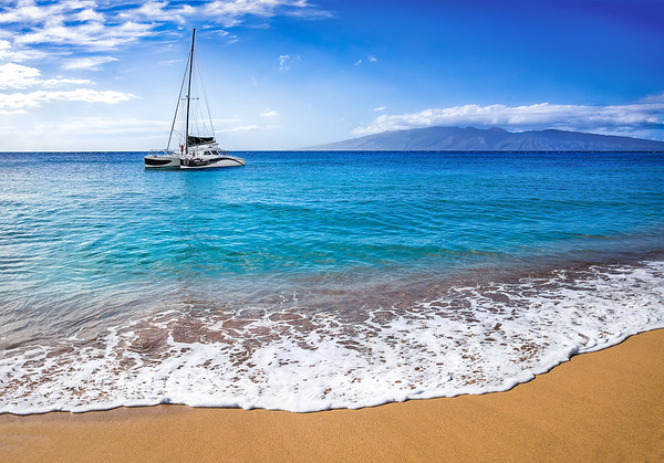 Boat in ocean with sand