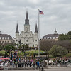 It's tourist time in the city, St. Louis Cathedral overlooks Jackson Square in the background. Traditional French architecture within the lush, palmy semi-tropical city on the banks of the Mississippi