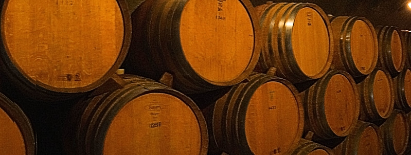Barrels in the cave at Gibbston Valley Winery