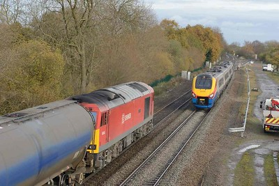 16 November 2017 :: As 60044 heads north at Stenson Junction, East Midlands meridian 222 101 is at a stop while working 5Z22, a circular trip out and back to Derby and is waiting to follow the oil train towards Sheet Stores Junction