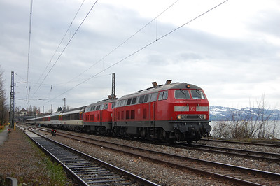 A few minutes later, 218421 + 218498 are pictured again crossing the causeway out of Lindau with EC 193, the 0747 from Basel to Munchen. In the background on the right can be seen the 'Bodensee' and the lower slopes of the Swiss Alps (25/11/2017)